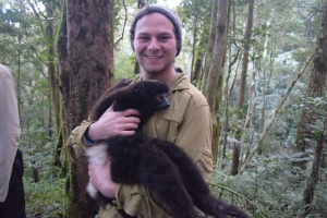 Holding a wild sifaka-they smell like maple syrup!